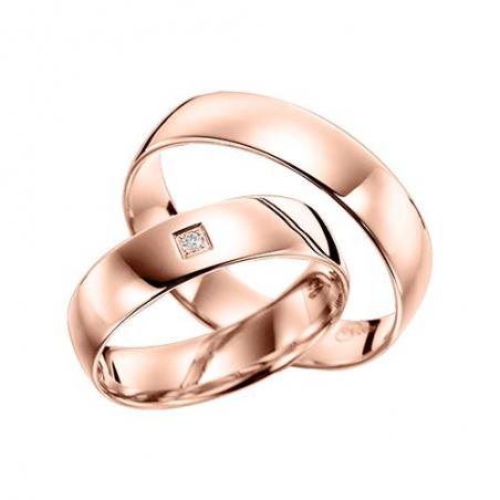 Изысканное кольцо из красного золота с голубым топазом и фианитами